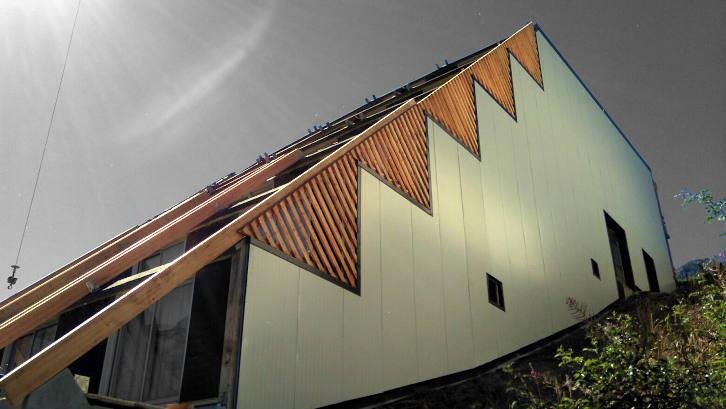 Charpente bois douglas de façade et panneaux isolants