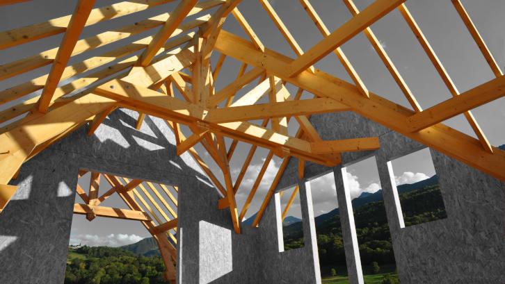 Charpente traditionnelle sur maison ossature bois
